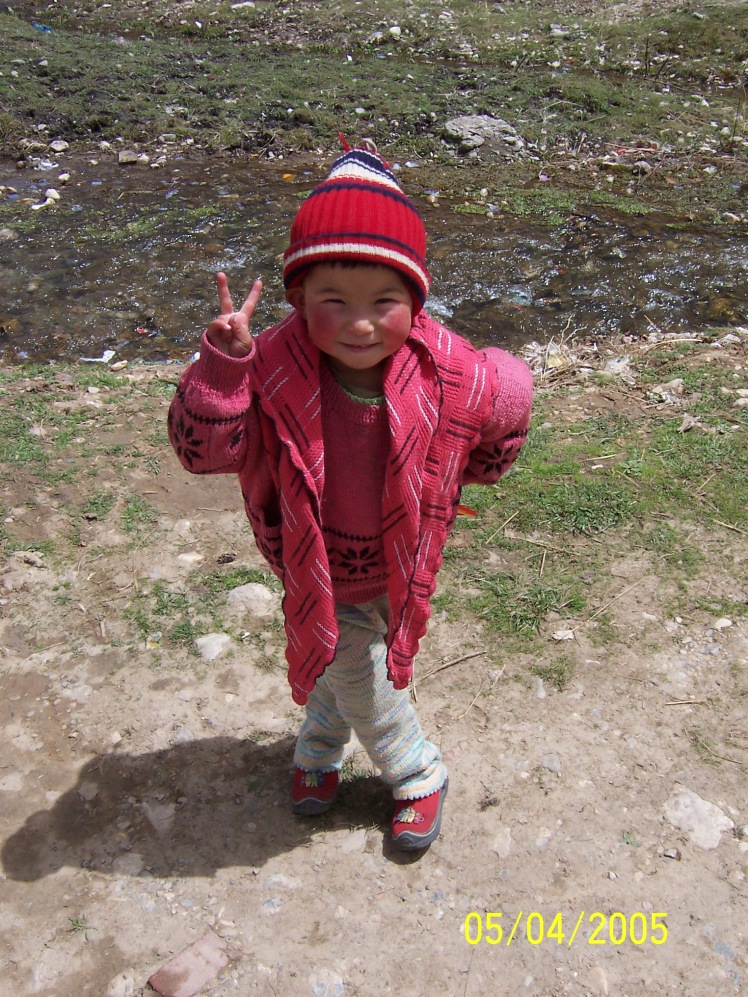One of the adorable little girls I met in the town of Langmusi, Gansu province, China. She's definitely Chinese--striking the neccessary peace sign symbol in the photo.
