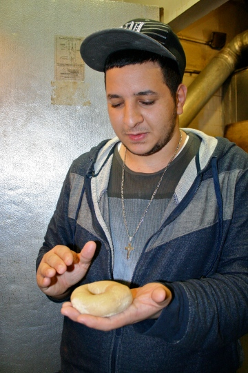Mario showing me something about the texture of the dough.